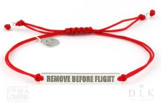 """Bransoletka """"Czerwony sznurek z napisem Remove Before Flight"""""""