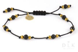 Bransoletka Onyks ze złotym hematytem na czarnym sznurku