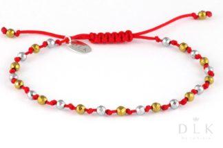 Bransoletka Srebrne i złote hematyty na czerwonym sznurku