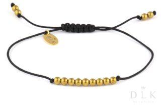 Bransoletka Złote hematytowe kulki na czarnym sznurku