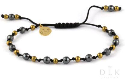 Bransoletka Czarno-złote hematyty na czarnym sznurku