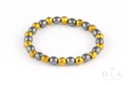 Pierścionek elastyczny z czarnych i złotych hematytów