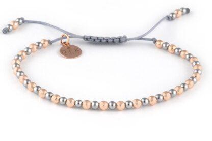Bransoletka Różowo-srebrne hematyty na szarym sznurku
