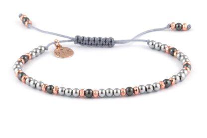 Różowo-srebrno-czarne hematyty na szarym sznurku