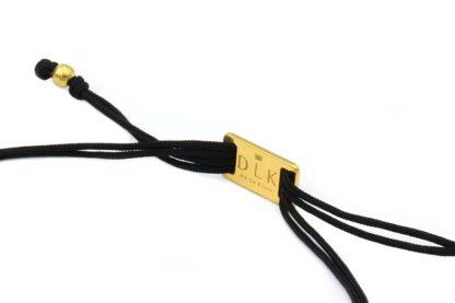 Zamknięcie bransoletki na sznurku